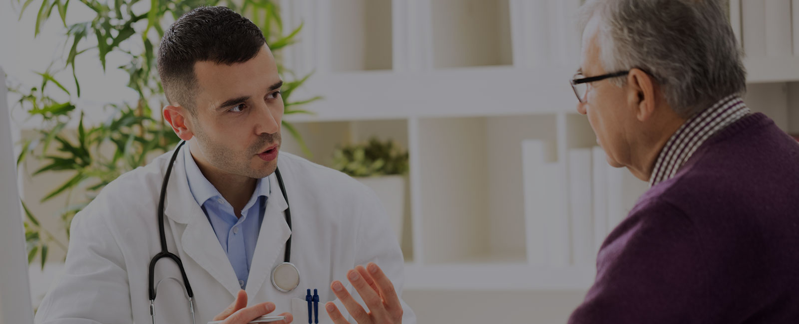 ent physician talking to patient